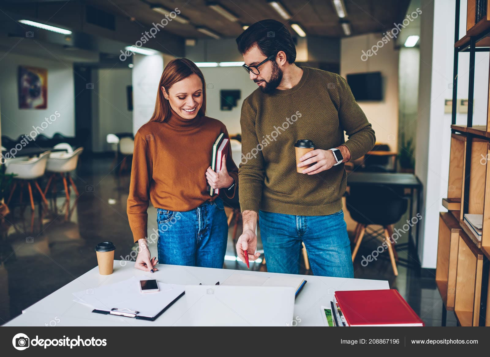 Stock photo two young casually dressed colleagues.
