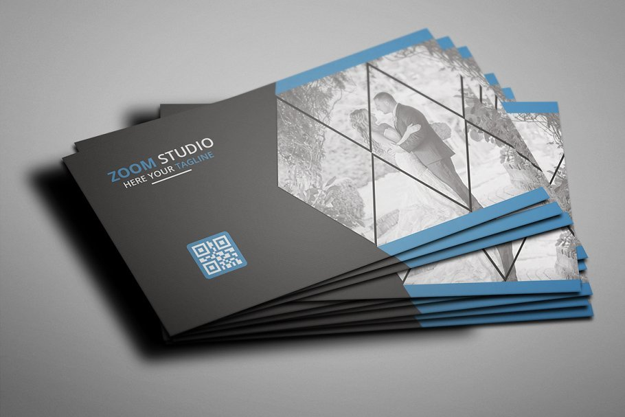 Black matte cards with blue geometric shapes and photography.