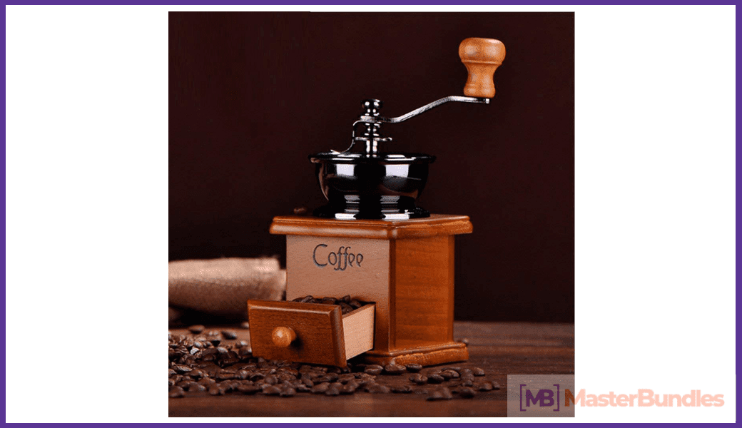 Coffee grinder machine in vintage style and manually operated.
