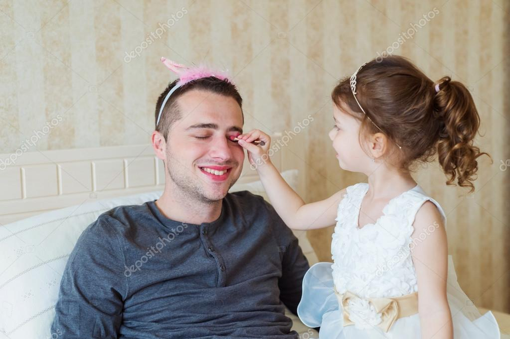 130+ Best Free Happy Fathers Day Graphics 2020: Images, Clipart, Fonts - depositphotos 109852068 stock photo cute girl putting on make
