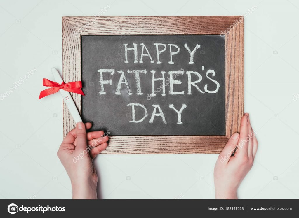 130+ Best Free Happy Fathers Day Graphics 2020: Images, Clipart, Fonts - depositphotos 182147028 stock photo cropped shot woman holding pregnancy