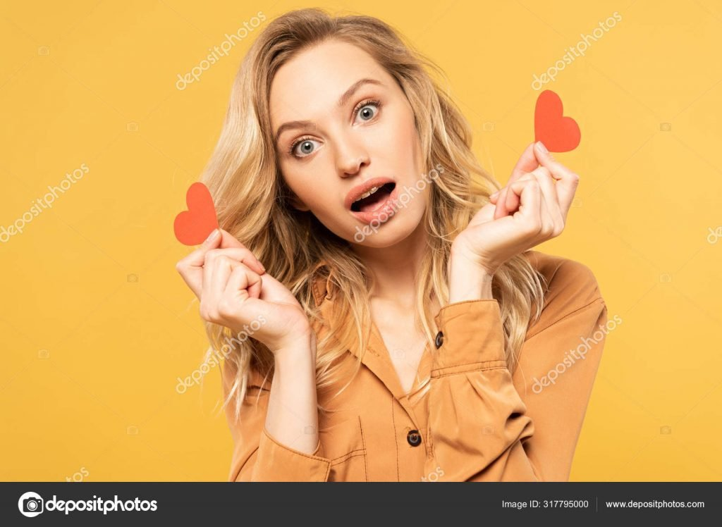 St. Valentines Day Stock Photos & Images. Photo Deal: 100 Royalty-free Photos & Vectors – $69! - depositphotos 317795000 stock photo exited blonde woman holding paper