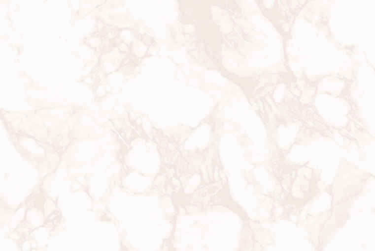 White marble background with delicate pink blurs all over the background.