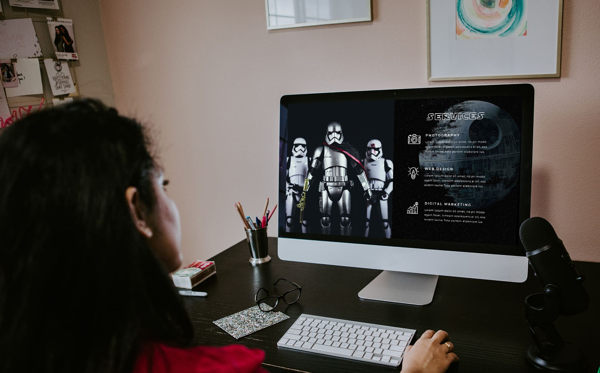 Girl is watching a slide with Captain Phasma picture with the Stormtroopers.