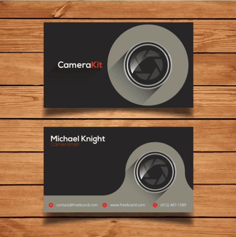 Black-gray card with a lens. Two colors are used for the font - white and red.