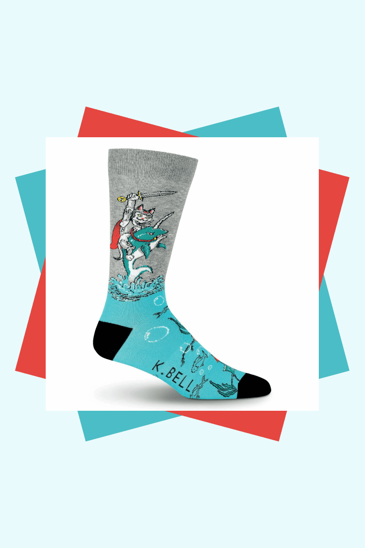 Bright gray-turquoise socks with a picture of a warrior cat will be a good addition to your collection.