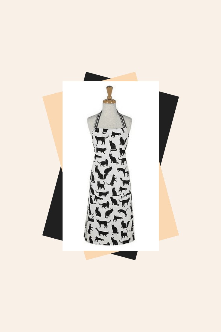 White apron with black drawings of cats. Remember your pet even while cooking.