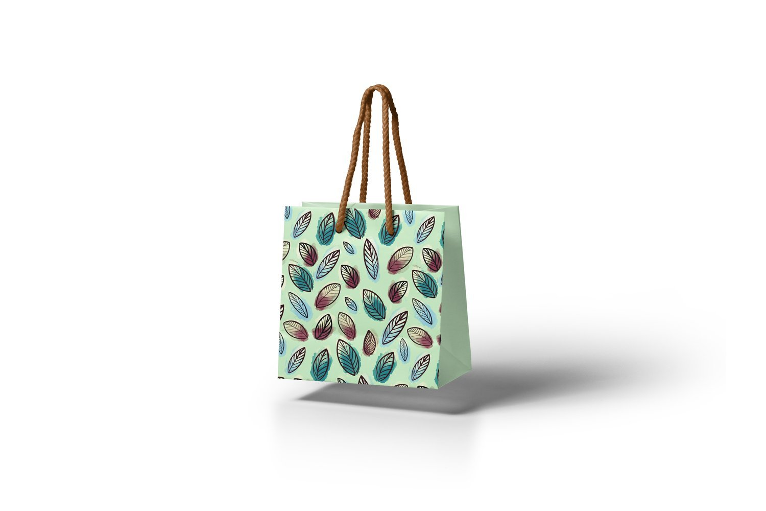 Green bag with leaves.