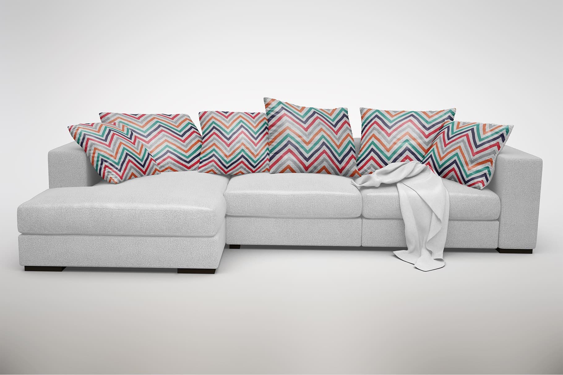 Decorative pillows with multicolored herringbone print.
