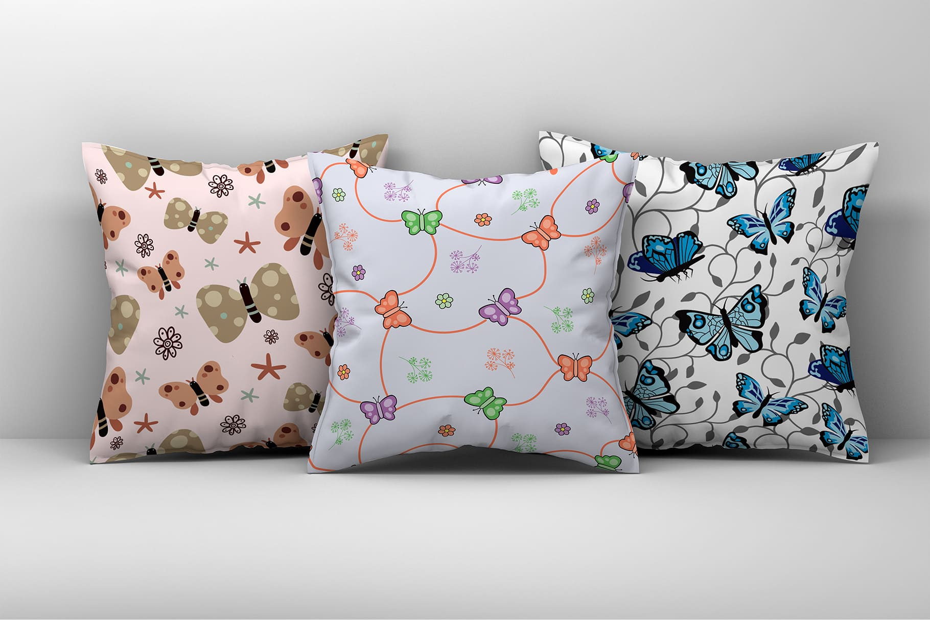 Decorative pillows in pastel colors with butterflies.