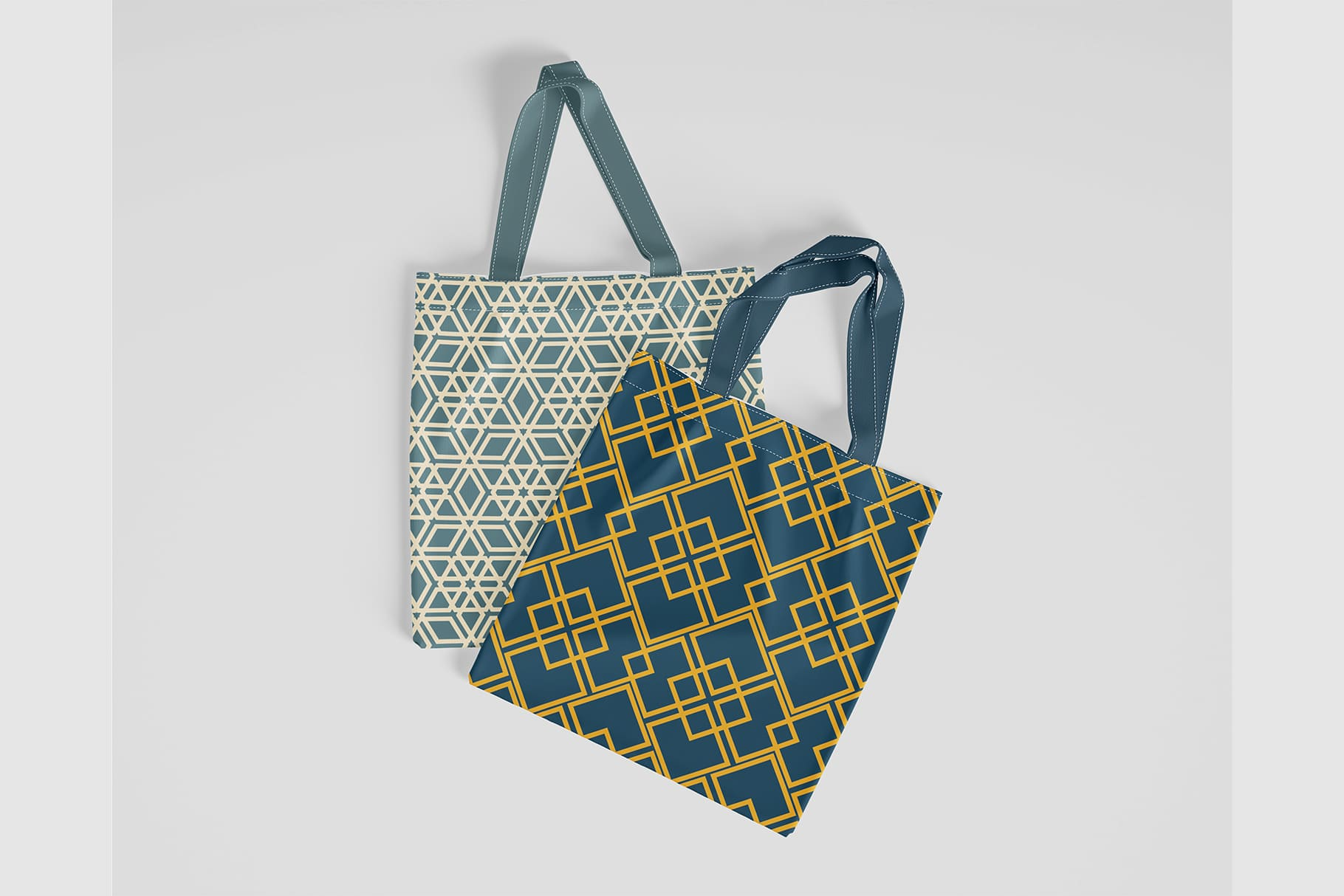 Two eco bags with a geometric print.