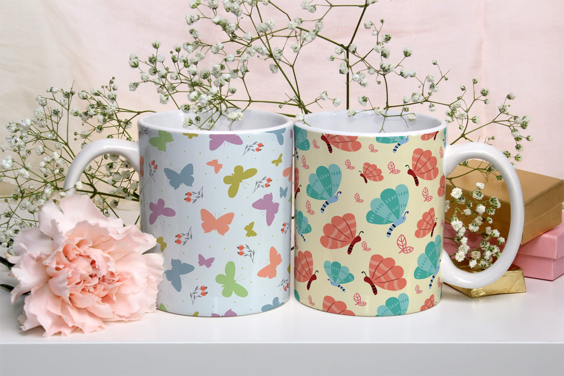 Two cute cups with small butterflies.