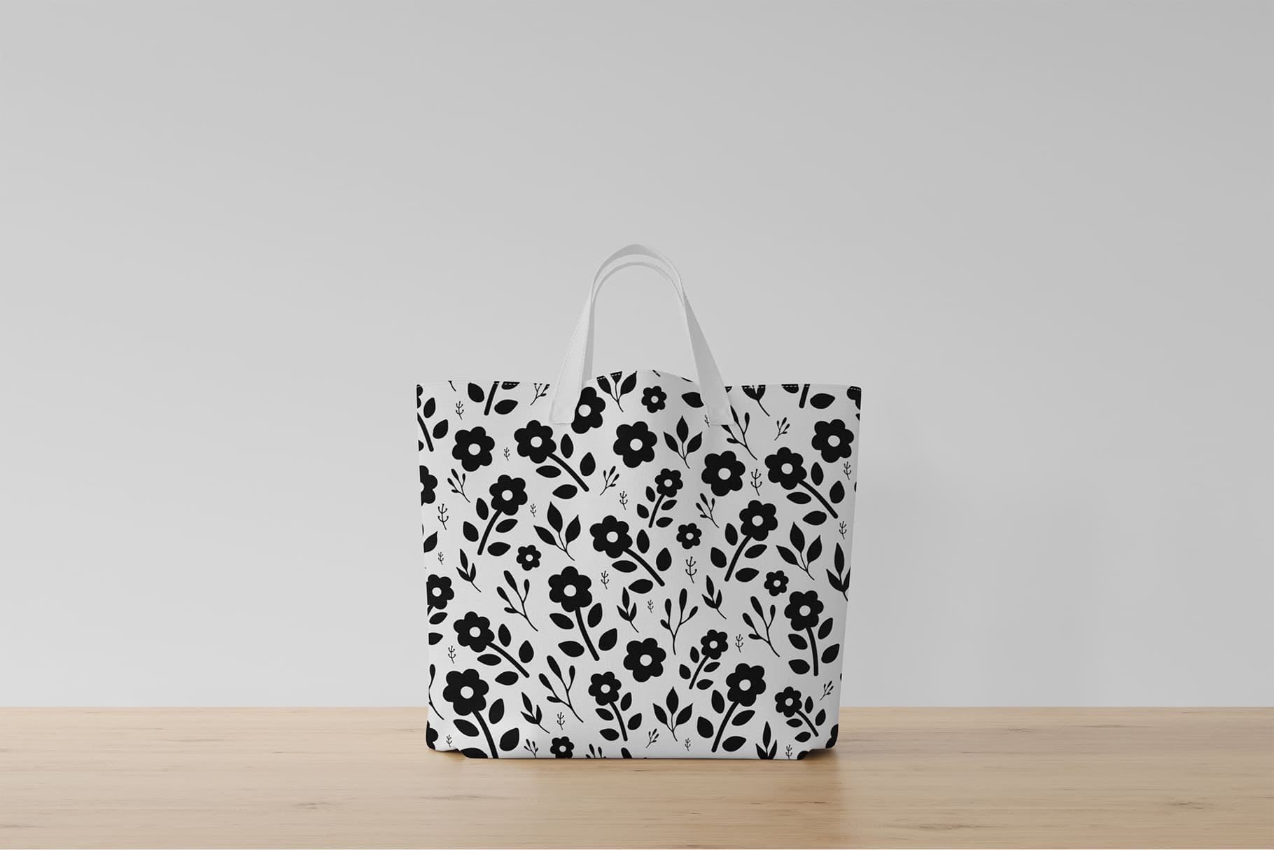 White bag with black flowers.