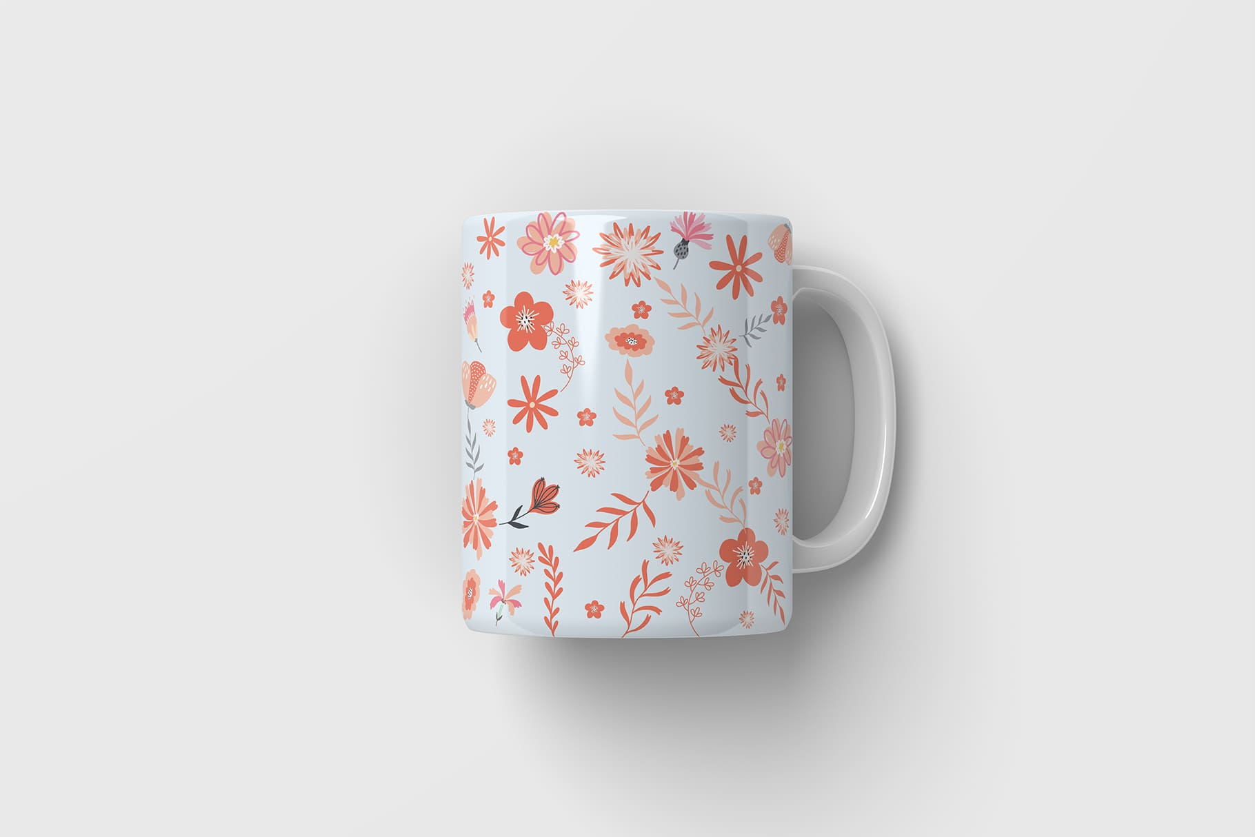 White cup with small flowers.