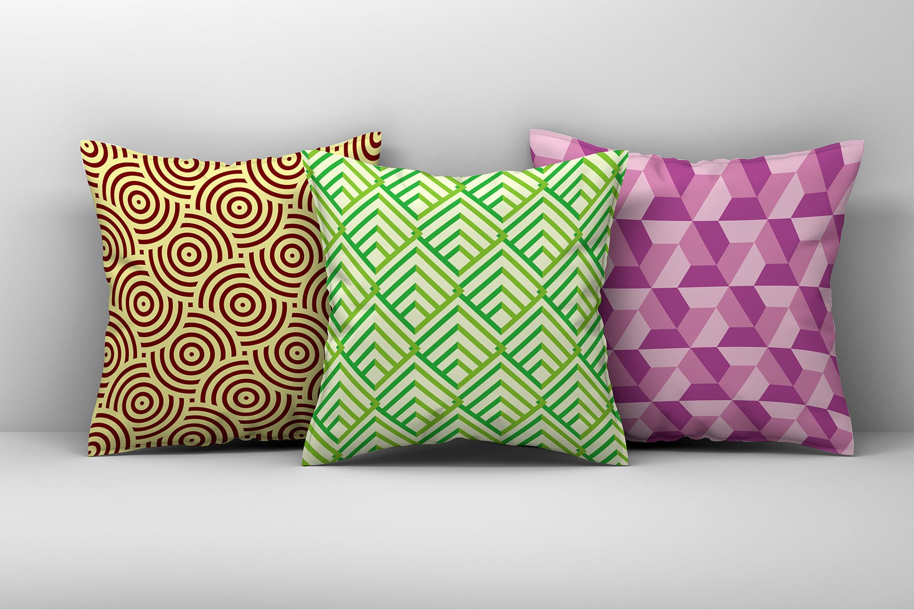 Decorative pillows in different colors with geometric print.