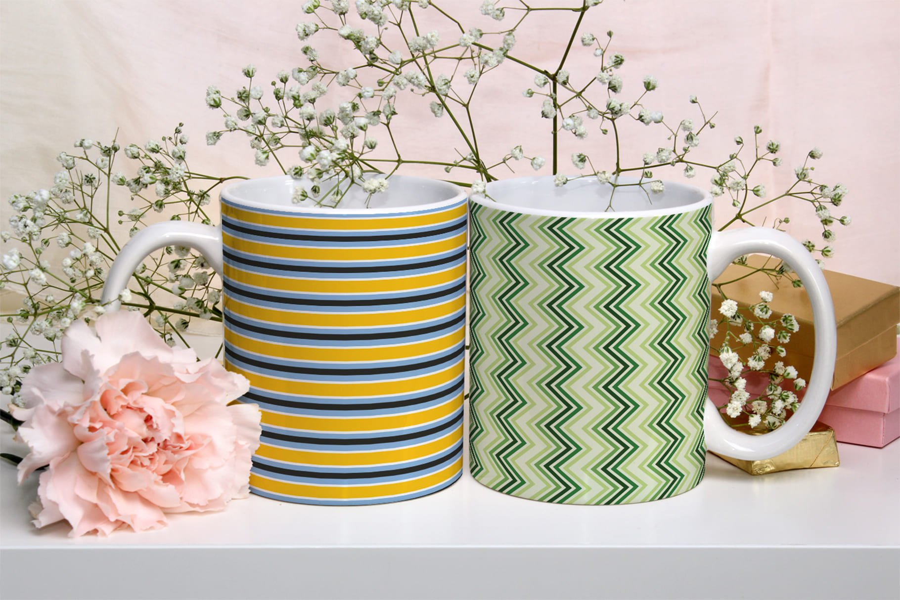 Two cups - one with lines, the other with a herringbone print.