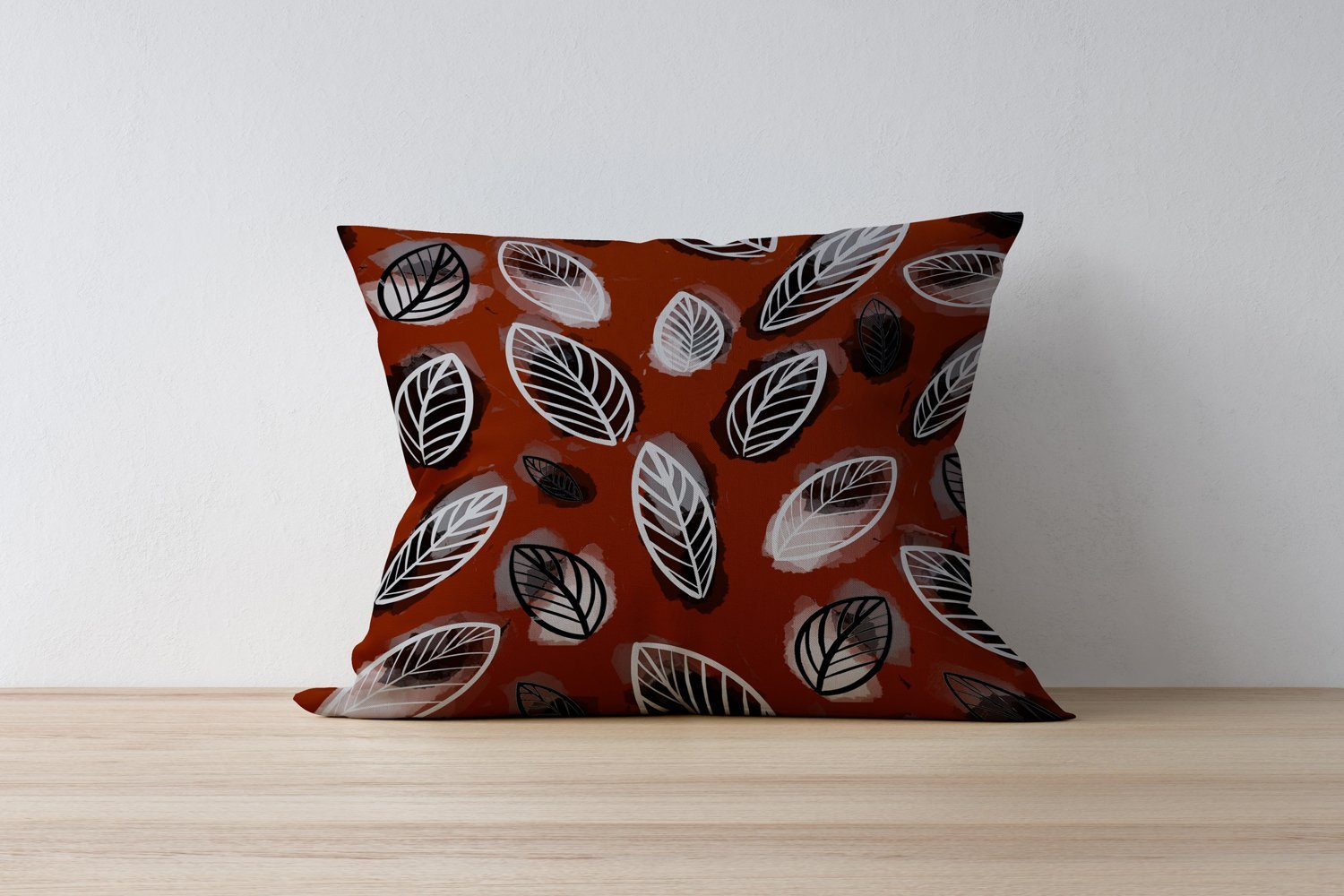 Red pillow with leaves.