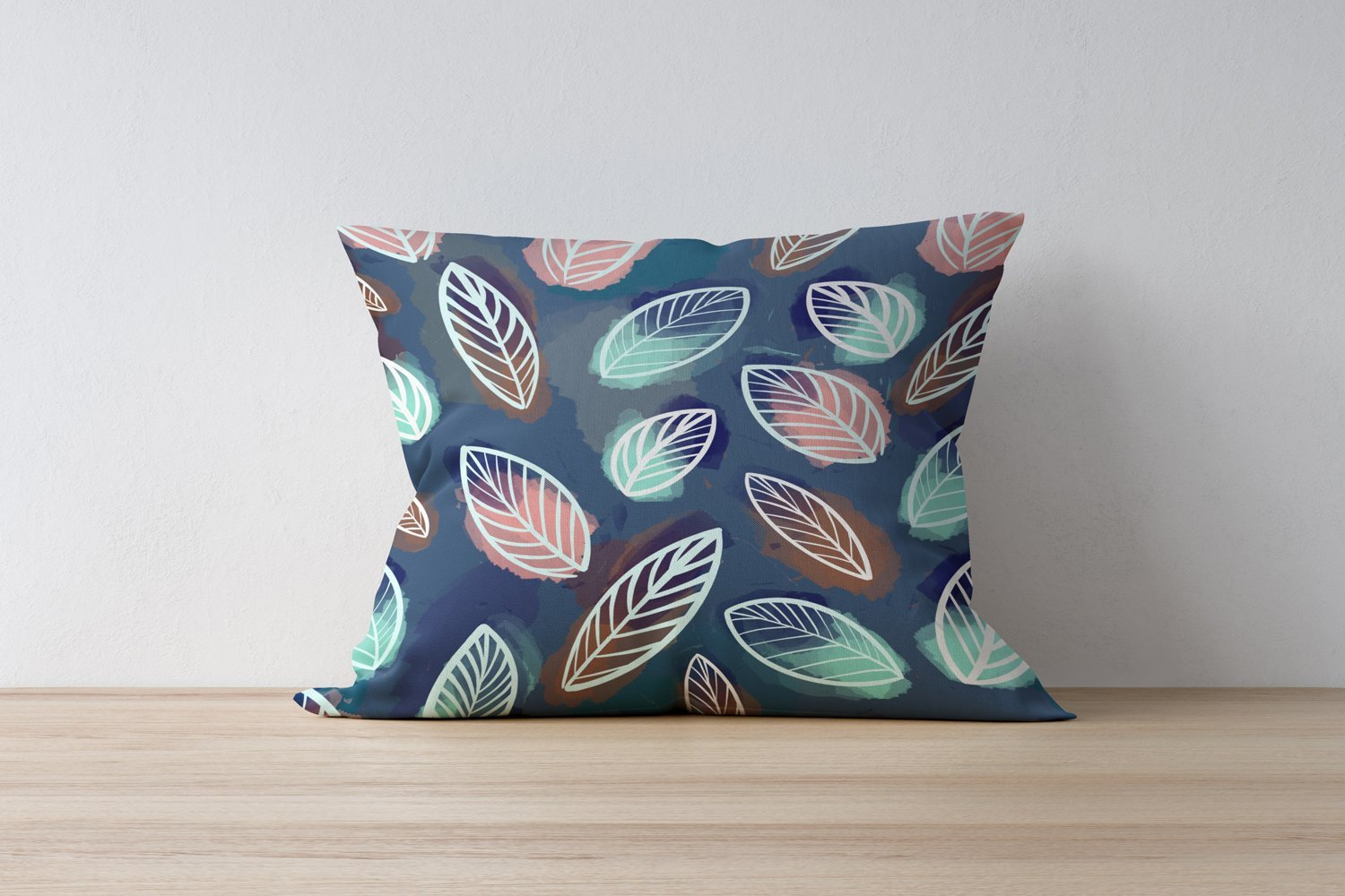 Colorful pillow with leaves.