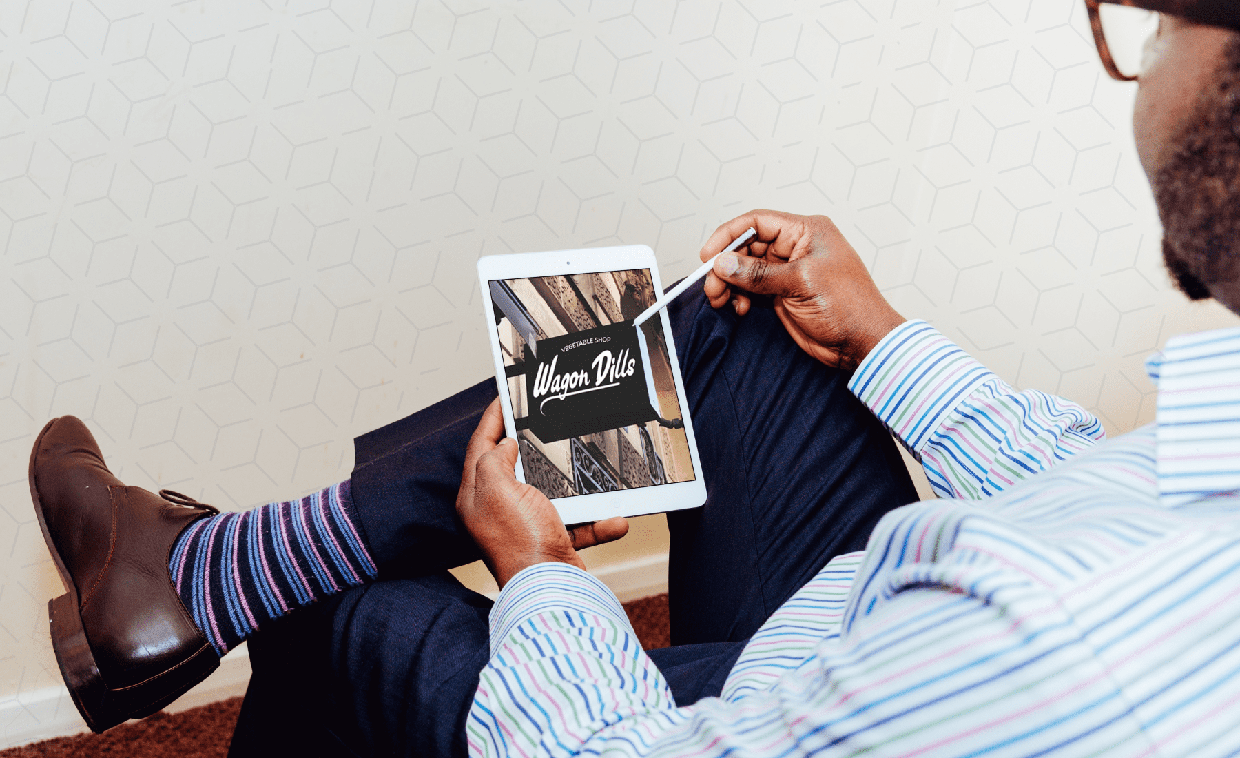 A man in striped socks with a tablet. Handwritten Fonts Bundle.