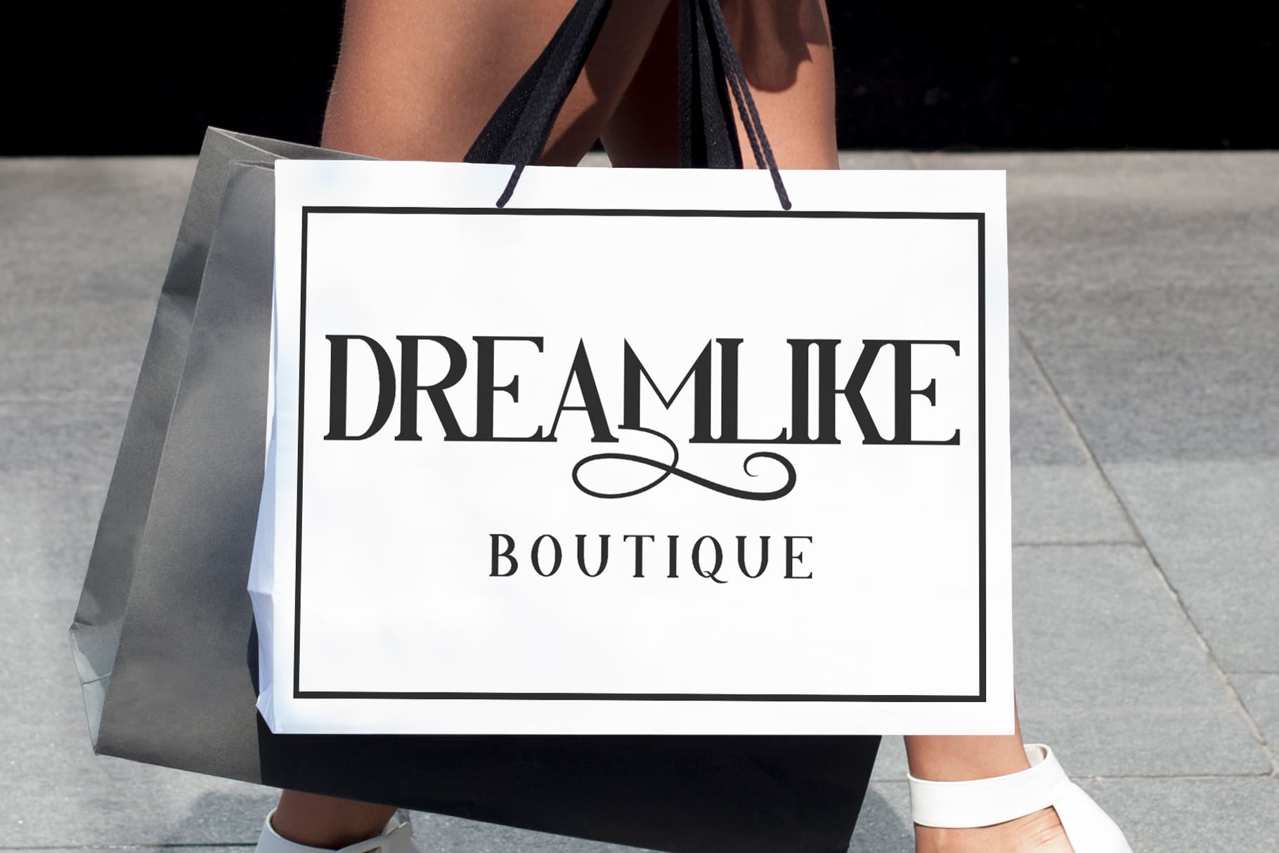 In the style of the best boutiques - the unfolding and laconic inscription on the branded bag.