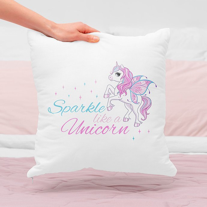 Pink unicorn on the pillow.