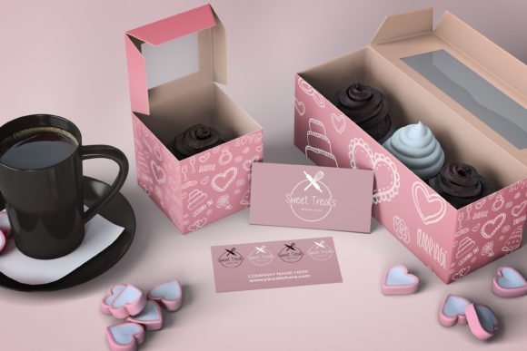 Delicate pink boxes with cakes and a cup of coffee.
