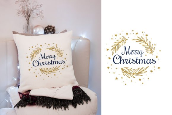 White decorative pillow with golden Christmas illustration.