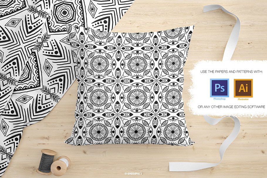 This decorative pillow is completely decorated with black and white ornaments.