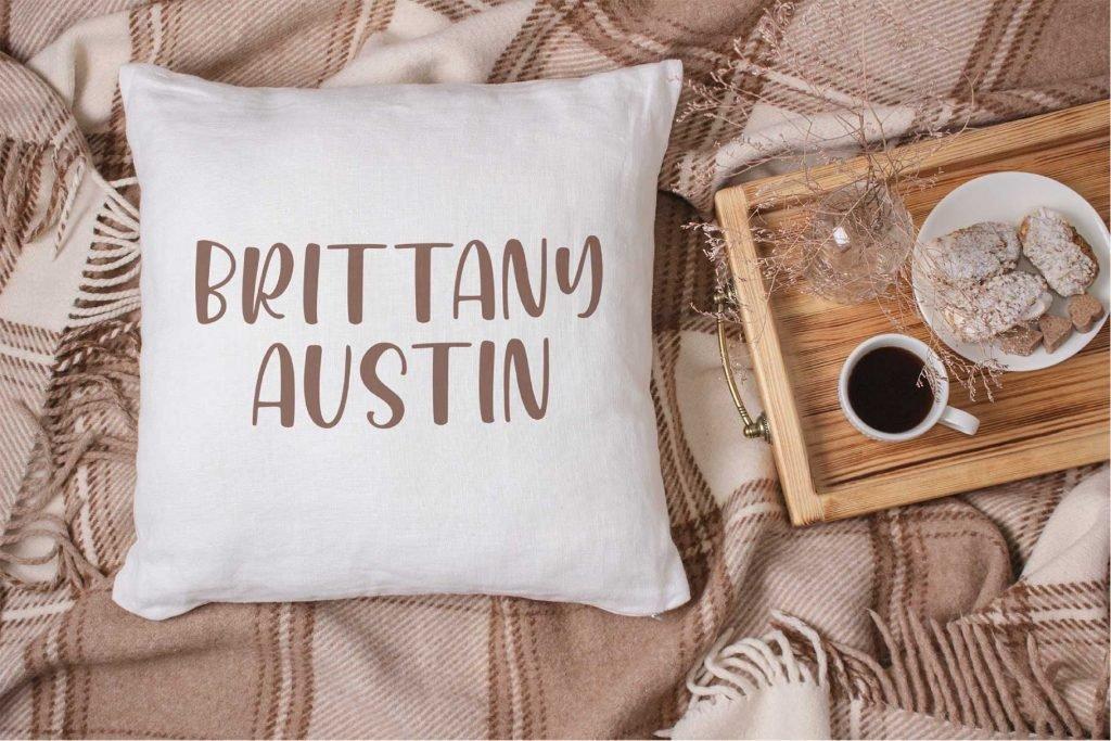 Honey Mints Handwritten Font in a Pillow Mock up.