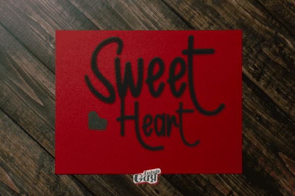 Matte red paper with embroidered black lettering.
