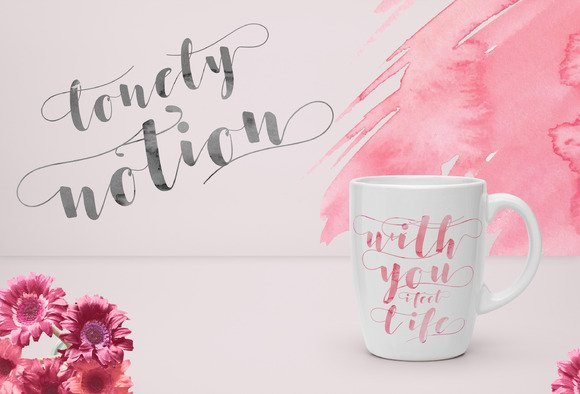 Pink watercolor wall with a cup.