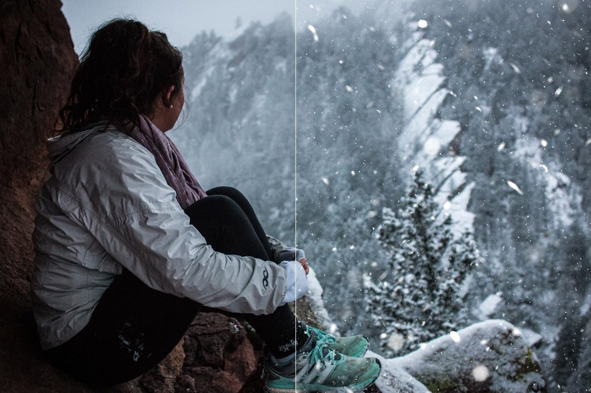 A beautiful girl sits in a cave and watches the snowfall from the mountain.