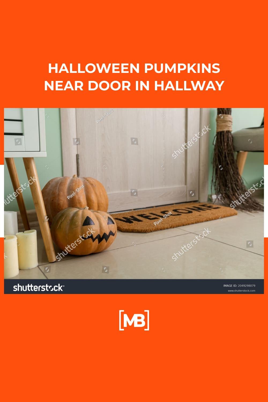 16 Halloween pumpkins near door in hallway