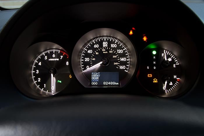Illuminated sports car dashboard closeup photo