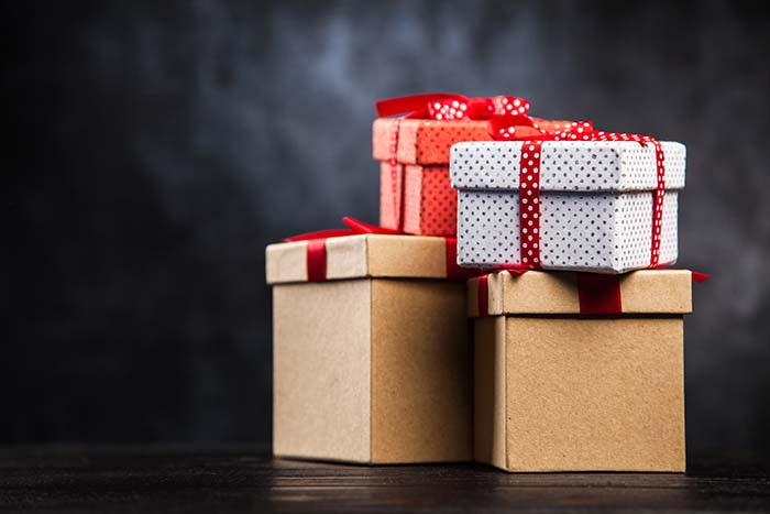 Stack of gift boxes on dark background