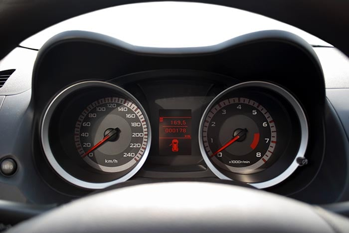 Isolated dashboard of a car, you can insert anything in front of the car