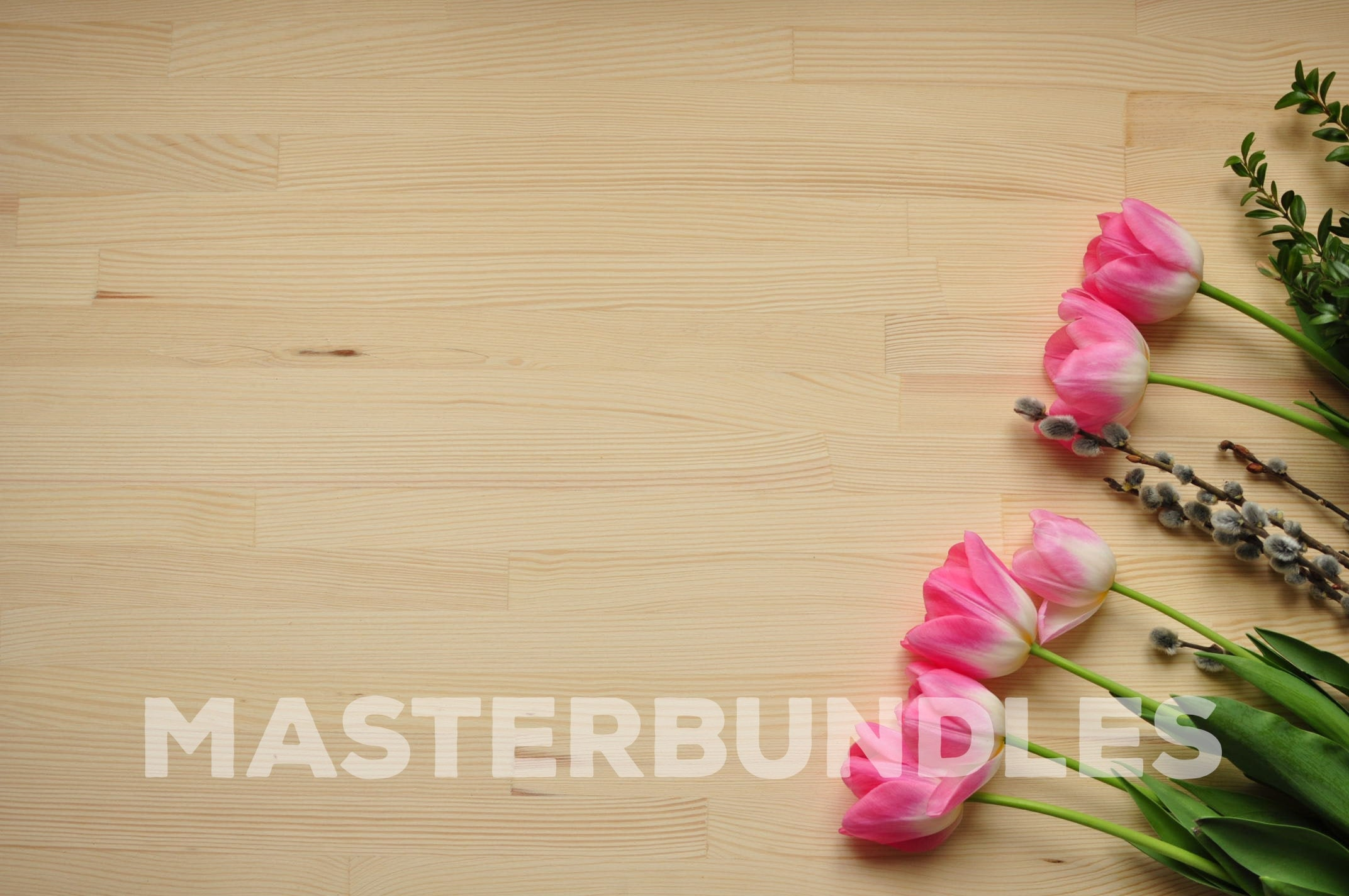 A wooden surface with pink tulips on it.
