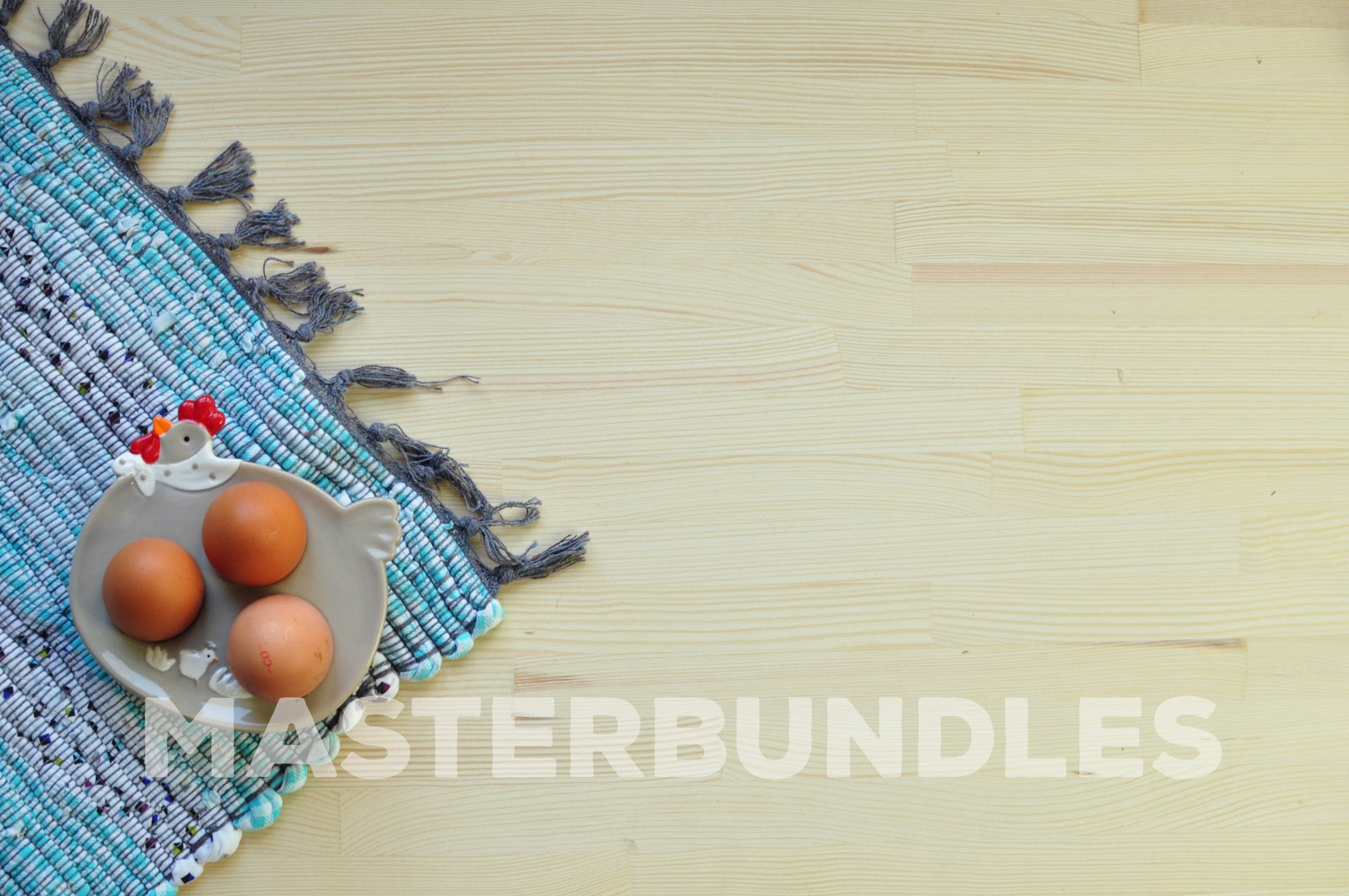 Three chicken eggs in a special stand and on a blue rug.