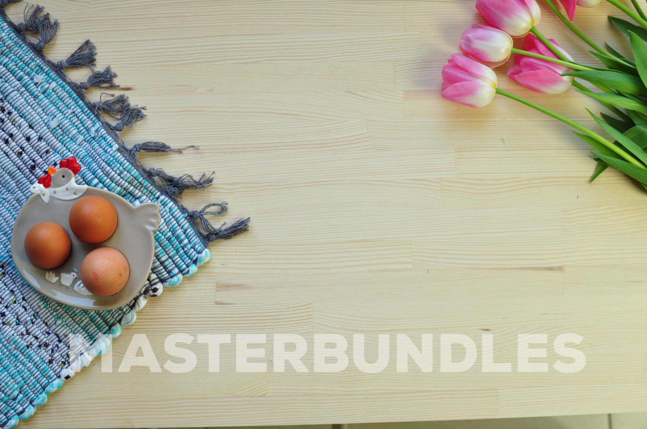 Three chicken eggs in a special stand and on a blue rug with fringes and flowing tulips.