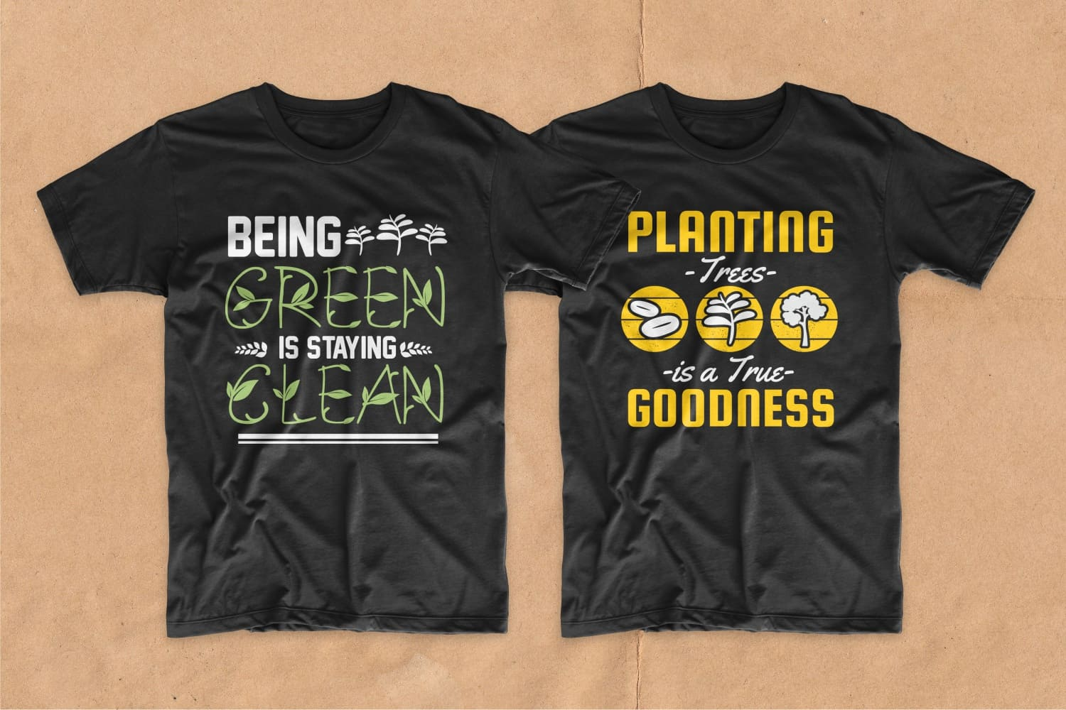 Two black T-shirts with green and yellow lettering.