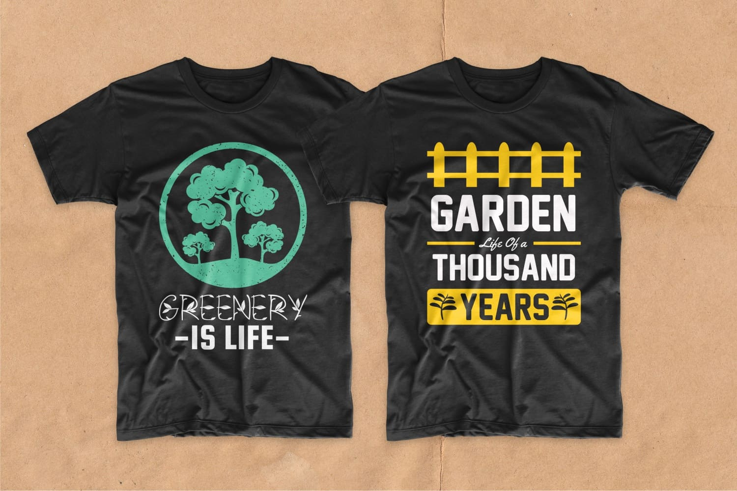 Two black T-shirts, one of which has a green tree painted on it.