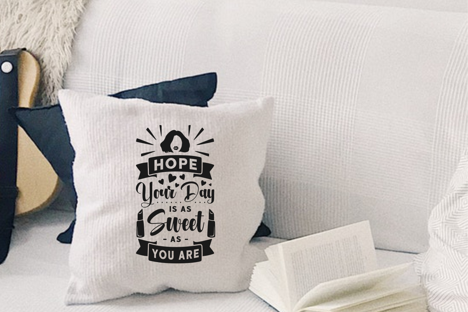 Two decorative pillows - light and dark with embossed lettering.