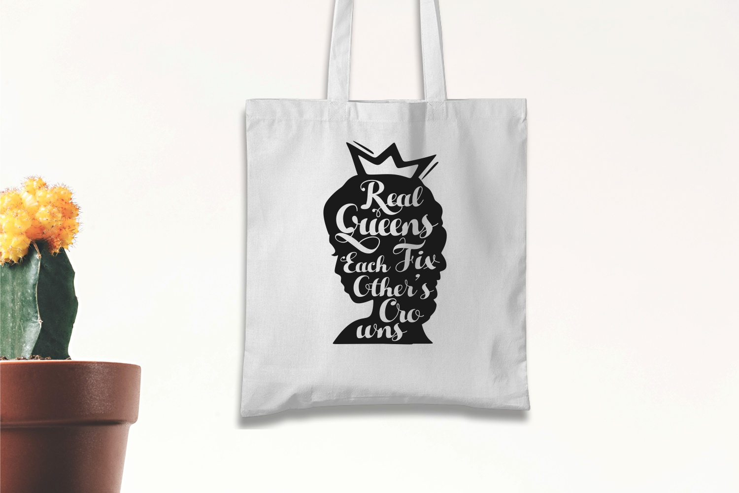 White eco-friendly bag with lettering and crown.