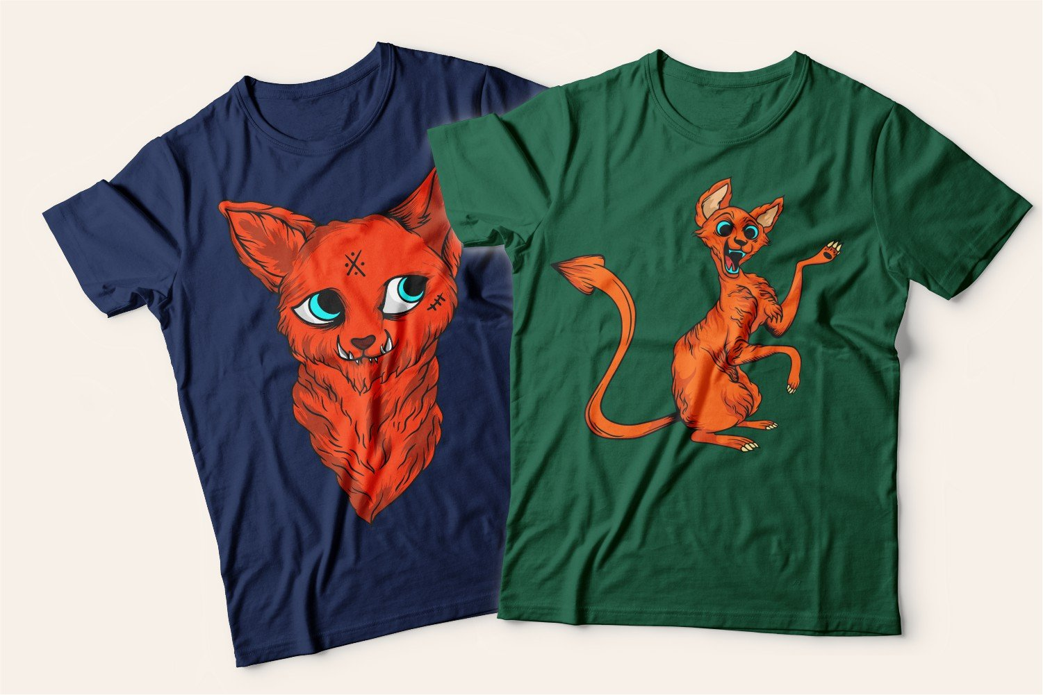 Two T-shirts with cats: one blue with a playful apologetic kitty, the other green with a skinny ginger cat.