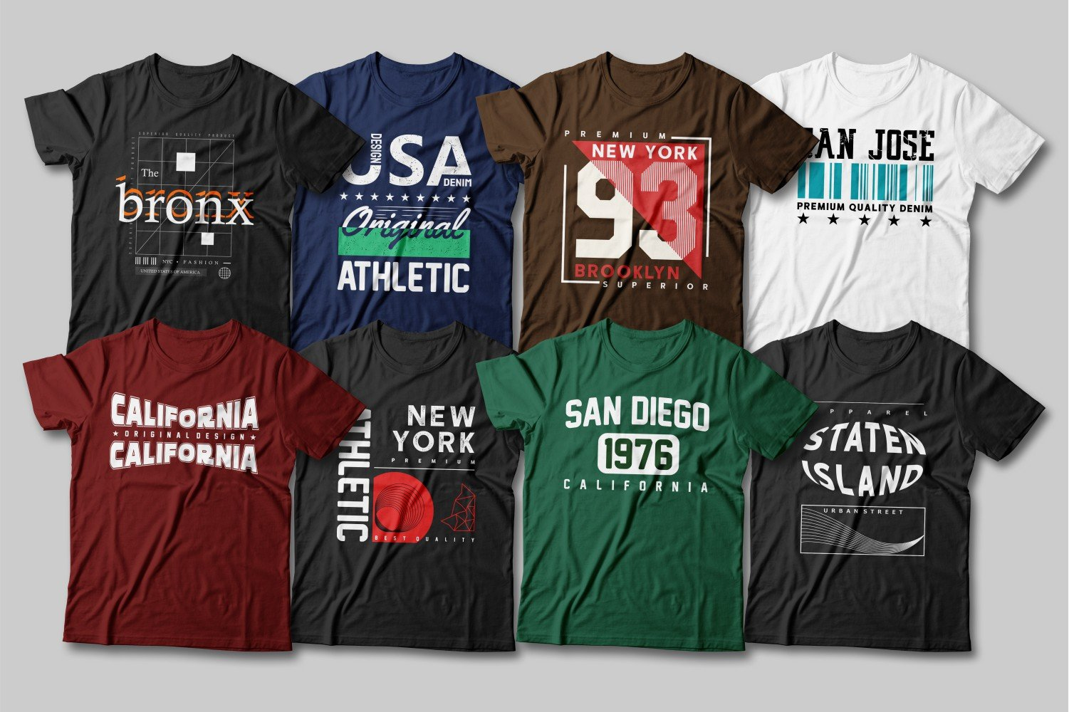 Multicolored T-shirts with different inscriptions and fonts.