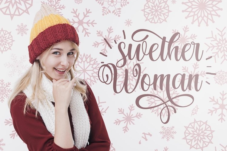 Girl on a background of snowflakes in a knitted scarf and hat.