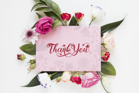 Delicate white card with red flowers and the inscription gratitude.