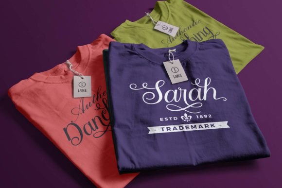 Three brightly colored T-shirts with two rows of text.