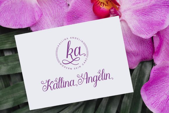 White business card with crimson font on the background of the orchid.