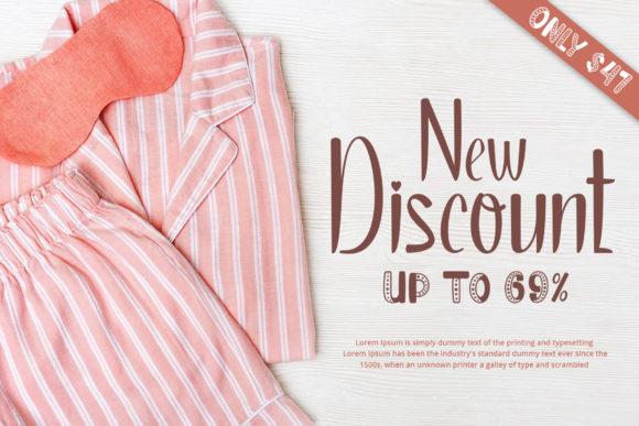 Pink striped pajamas with sleep mask.